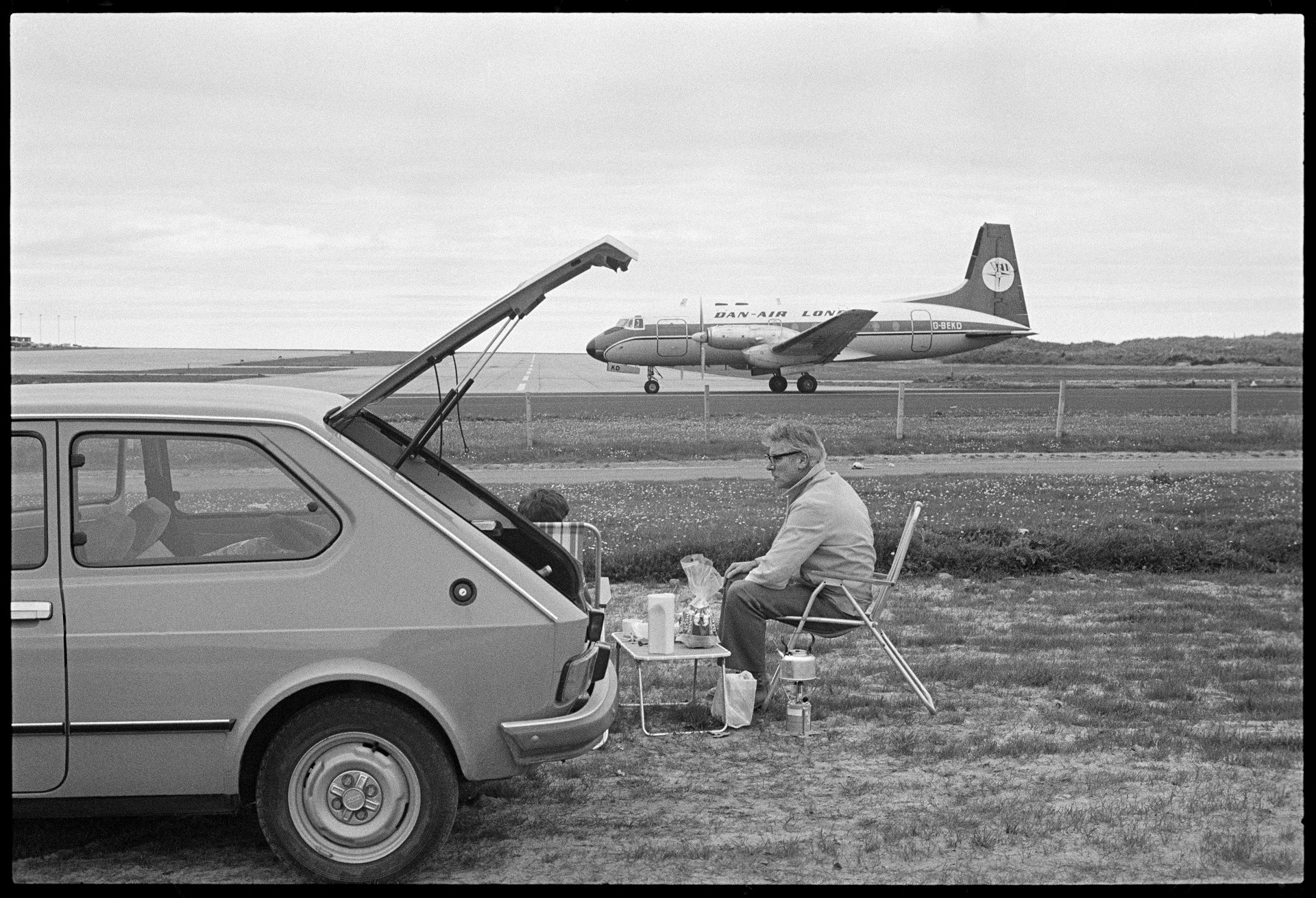 Image of Couple Picknicking Next to Sumburgh Airport by Tom Kidd