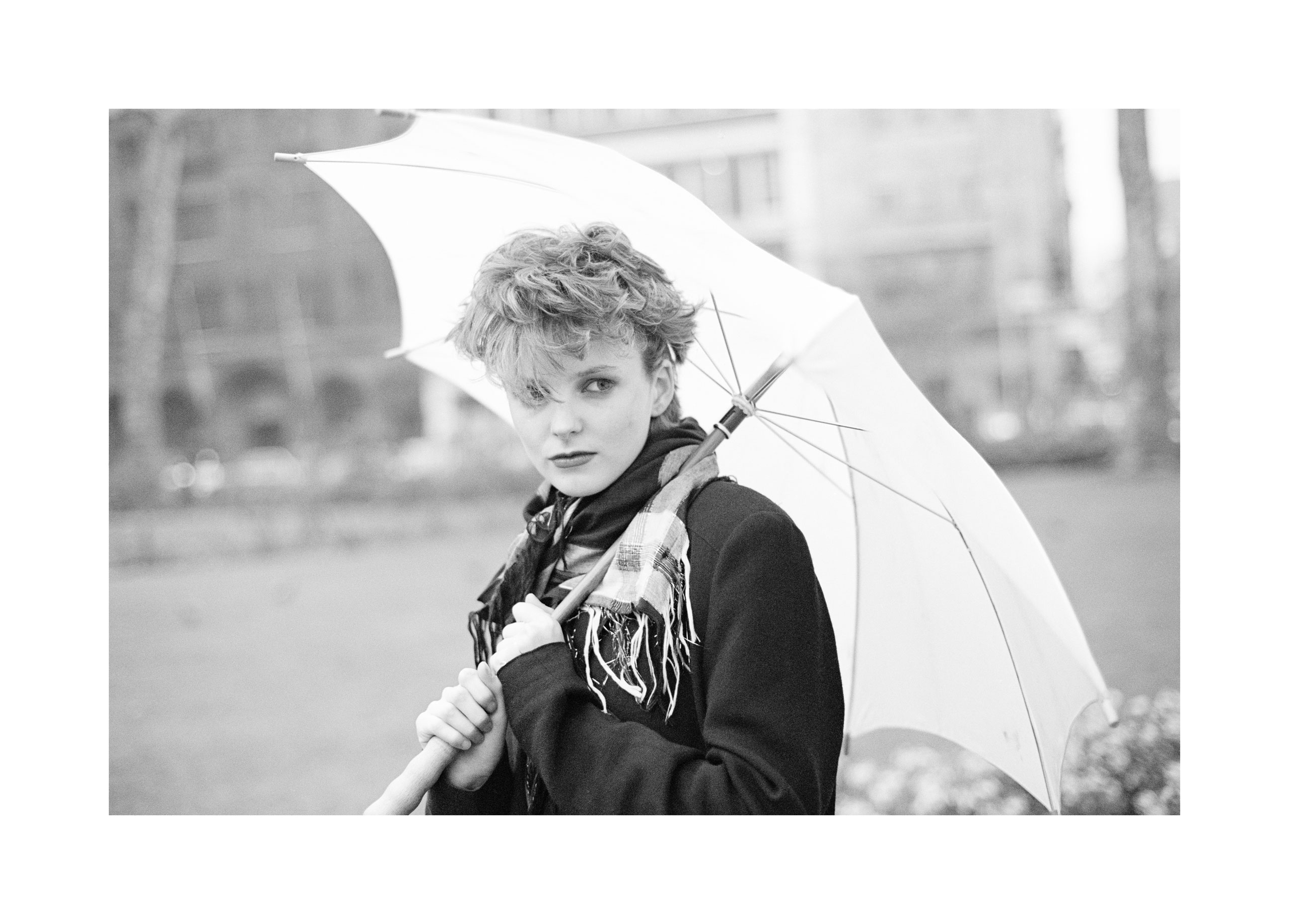 Image of Claire Grogan (with Umbrella) by Harry Papadopoulos